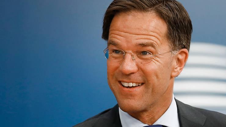 ARCHIV - Mark Rutte, Ministerpräsident der Niederlande, kommt zum EU-Gipfel in Brüssel. Der niederländische Premier ist ein Phänomen: Immer munter, immer charmant. Foto: Francois Lenoir/Reuters Pool/AP/dpa