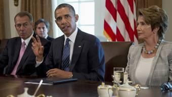 Der Vorsitzende des Repräsentantenhauses, John Boehner (l.), rief seine Kollegen auf, sich ebenfalls hinter den Präsidenten zu stellen.