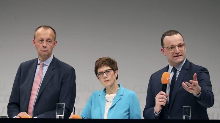 Die drei Kandidaten für die Merkel-Nachfolge: Friedrich Merz, Annegret Kramp-Karrenbauer und Jens Spahn (von links).