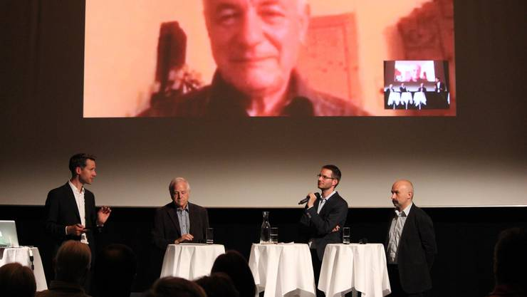 V. l. Moderator Mike Bucher sowie die Gäste Paul Stopper, Marius Christen und Manfred Josef Pauli sowie per Skype Hermann Knoflacher.