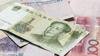 Renminbi-Noten: Der Internationale Währungsfonds IWF prüft, ob die chinesische Währung in den IWF-Währungskorb aufgenommen werden soll. Für China wäre es ein Prestigeerfolg (Symbolbild)