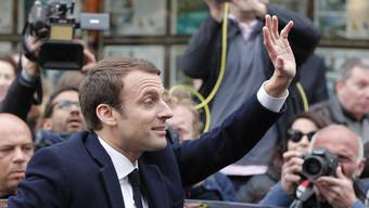 Centrist candidate Emmanuel Macron waves after voting in the first round of the French presidential election, in le Touquet, northern France, Sunday April 23, 2017. (AP Photo/Christophe Ena)