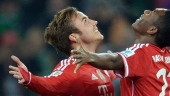1:0-Torschütze Mario Götze jubelt mit Teamkollege David Alaba