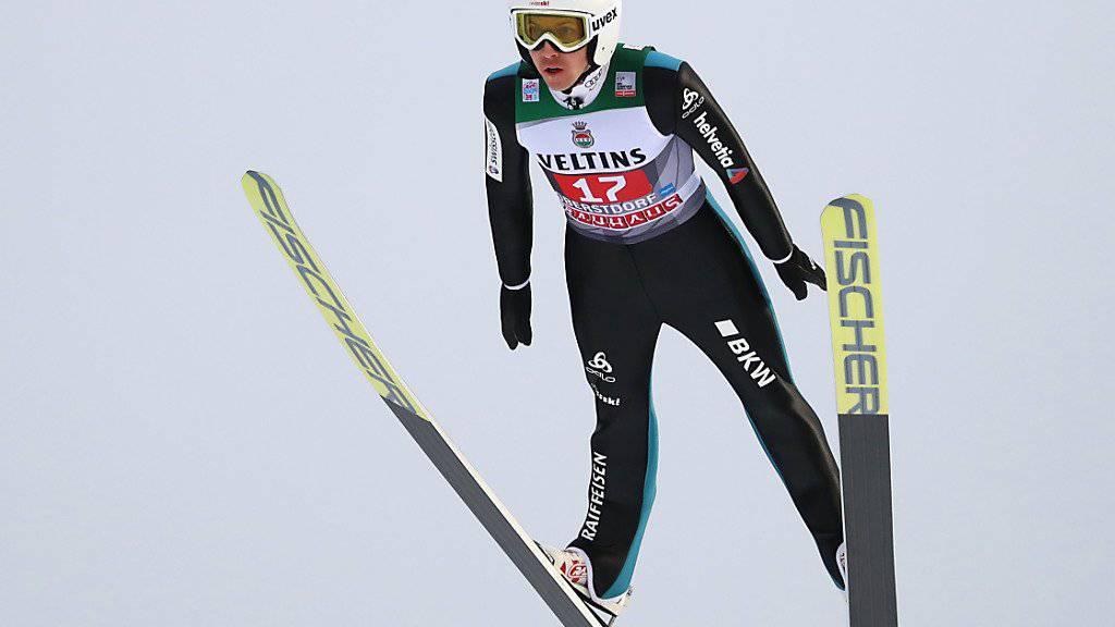Simon Ammann gewinnt das interne Schweizer Duell im ersten Durchgang.