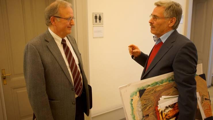 René Strickler und Theodore F. Kocher von der Espace Real Estate im Gang der Gerichtsgebäudes.