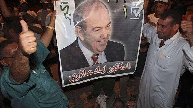 Anhänger Allawis feiern den Sieg