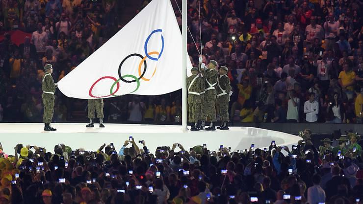 Wo wird die olympische Flagge 2026 gehisst werden?