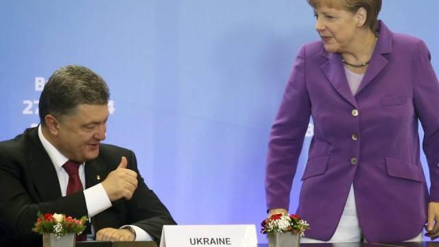Petro Poroschenko am Freitag mit Angela Merkel