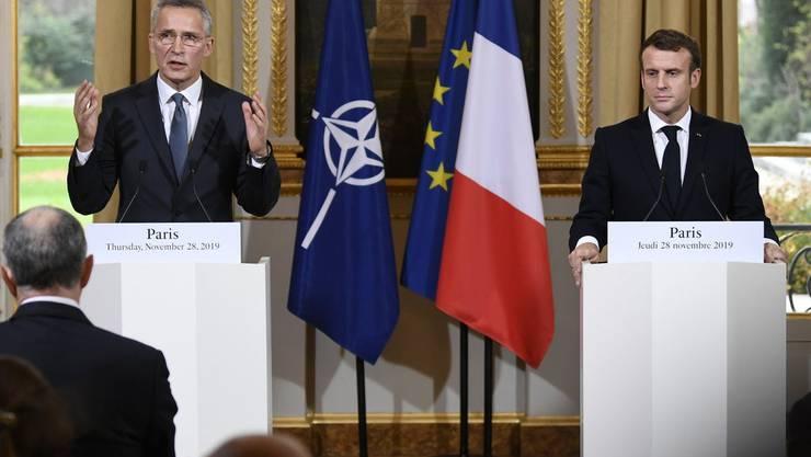 Nato-Generalsekretär Jens Stoltenberg (links) bei der gemeinsamen Pressekonferenz mit Emmanuel Macron.