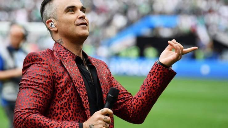 Robbie Williams feuert die britischen Fussballer an, aber er schwärmt für die deutschen, weil diese einen Siegeswillen haben. (Archiv)