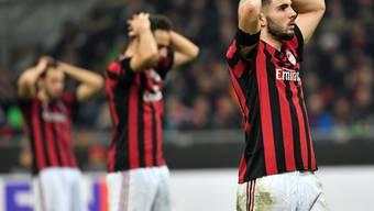 Bedrückte Gesichter: Milans Patrick Cutrone (re.) und seine Teamkollegen nach der 0:2-Pleite gegen Arsenal