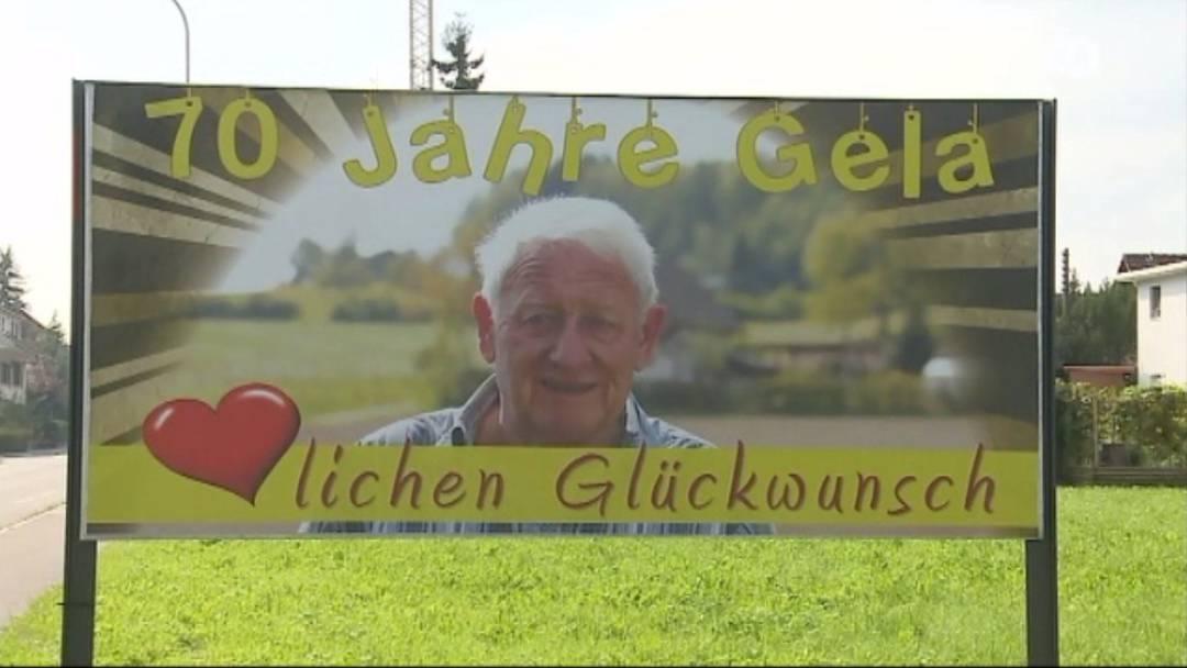 Wer ist der Mann auf diesem Glückwunsch-Plakat in Schafisheim?