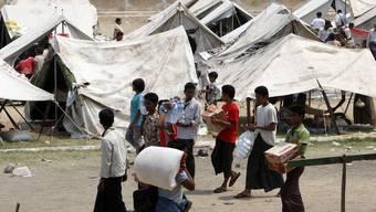 Ein improvisiertes Flüchtlingslager von Muslimen in Meiktila