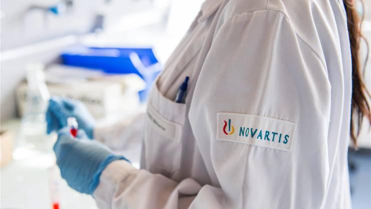 Reorganisation bei Novartis: Es trifft auch die Forschung. Yannick Bailly/Keystone