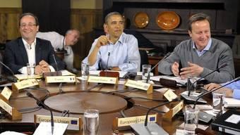 Zeigten sich in Camp David entspannt: Holland (r.), Obama und der britische Premier Cameron