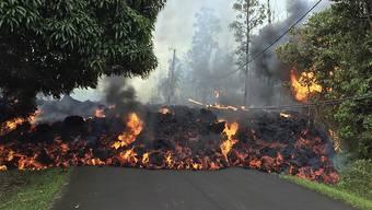 Lava des Vulkans Kilauea hat bisher auf Hawaii rund 30 Häuser zerstört.