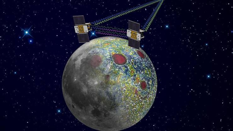 Ein Modell der Nasa zeigt, wie die Grail-Sonden Ebb und Flow ein Jahr dien Mond umkreist haben.