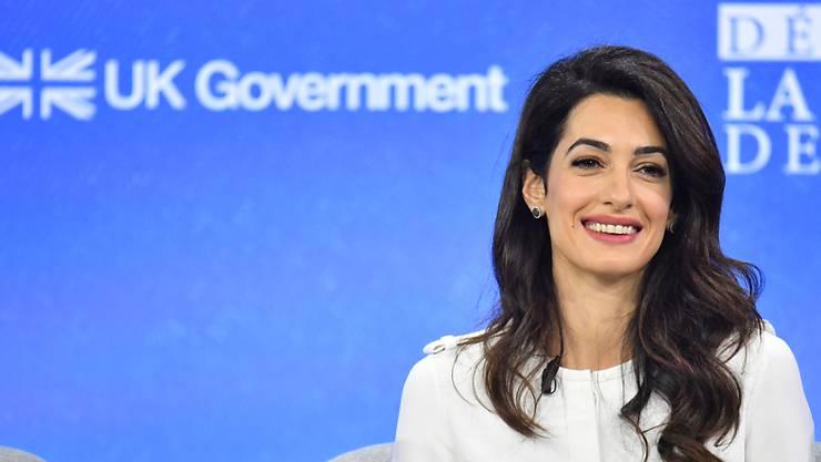 ARCHIV - Amal Clooney ist als britische Sonderbeauftragte für Pressefreiheit zurückgetreten. Foto: Dominic Lipinski/PA Wire/dpa