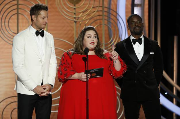 This image released by NBC shows presenters Justin Hartley, from left, Chrissy Metz and Sterling K. Brown during the 76th Annual Golden Globe Awards at the Beverly Hilton Hotel on Sunday, Jan. 6, 2019, in Beverly Hills, Calif. (Paul Drinkwater/NBC via AP)