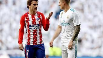 Patt im Madrider Derby: Atléticos Torschütze Antoine Griezmann (li.) diskutiert mit Reals Toni Kroos