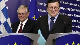 Der griechische Premier Lucas Papademos (l) und EU-Kommissionspräsident José Manuel Barroso in Brüssel