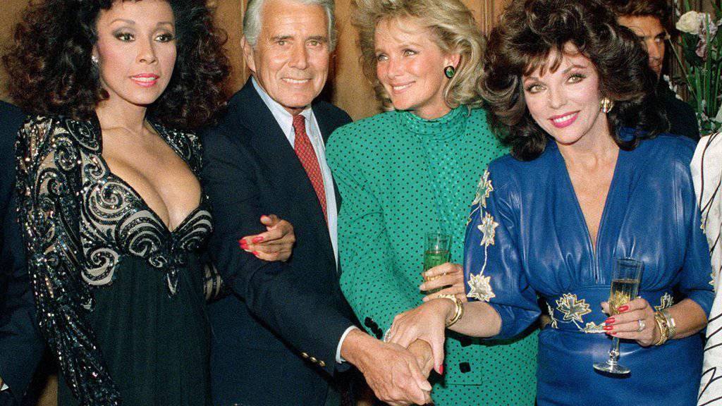 Die «Denver Clan»-Crew (von links: Diahann Carroll, John Forsythe, Linda Evans und Joan Collins) feiert 1986 in Los Angeles die Produktion der 150. Episode. Nun gibts eine Neuauflage der populären Serie.