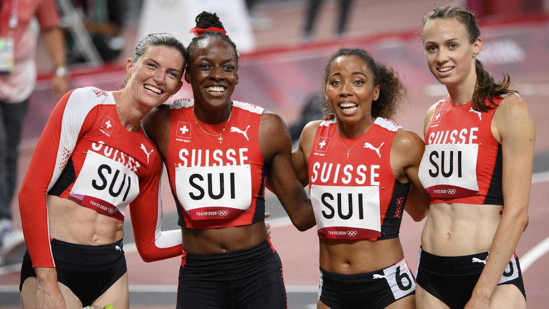 From left, Lea Sprunger, Yasmin Giger, Rachel Pellaud and Silke Lemmens of Switzerland react after crossing the finish line in the women's athletics 4x400m relay heat at the 2020 Tokyo Summer Olympics in Tokyo, Japan, on Thursday, August 05, 2021.