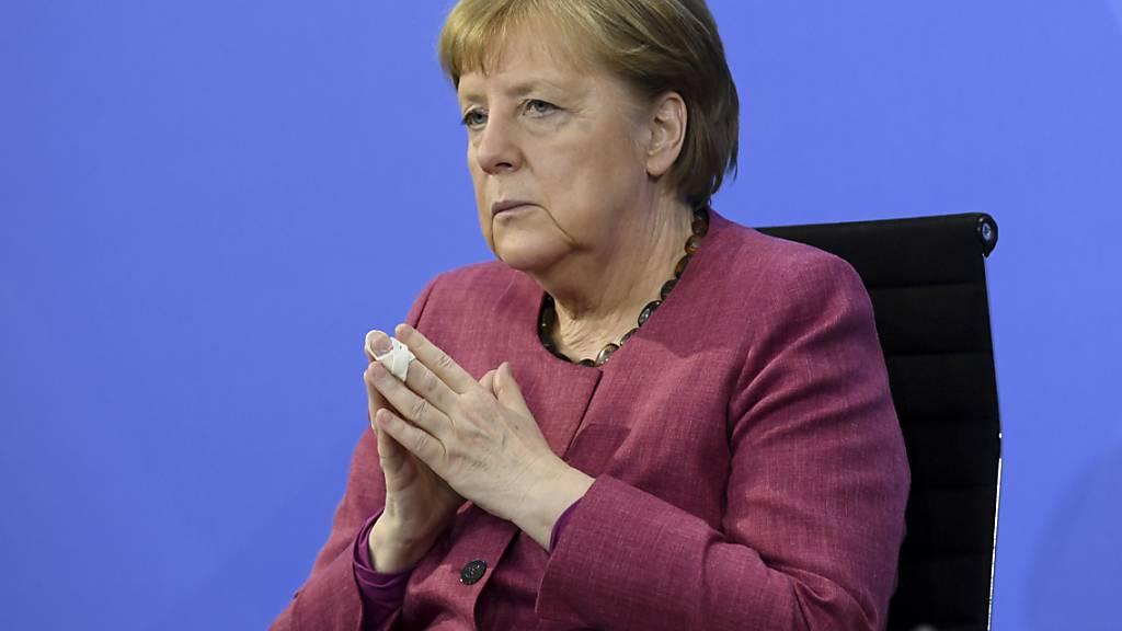 Bundeskanzlerin Angela Merkel nimmt an einer Pressekonferenz im Kanzleramt teil. Foto: Annegret Hilse/Reuters Pool/dpa