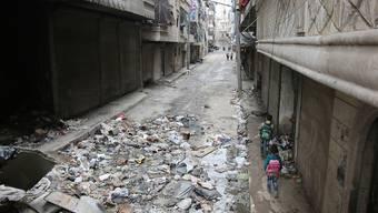 Kinder in den Strassen von Aleppo, einer der Städte, die unter dem Krieg in Syrien leiden.