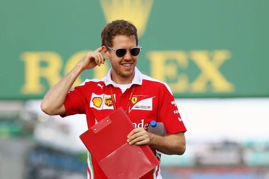 Ein lächelnder Sebastian Vettel in Melbourne © Keystone
