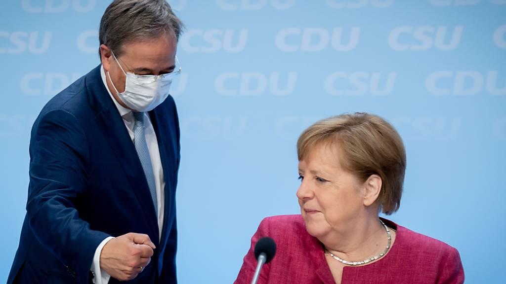 Die deutsche Bundeskanzlerin Angela Merkel und ihr möglicher Nachfolger Armin Laschet. Foto: Kay Nietfeld/dpa