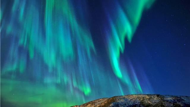 Der Schein trügt: Die faszinierenden Polarlichter sind nur die sichtbaren Auswirkungen eines Sonnensturms.