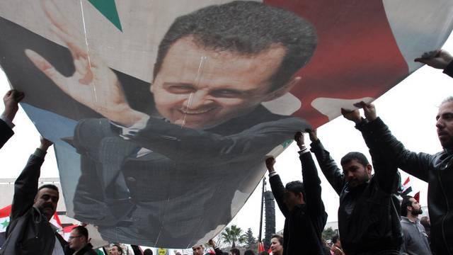 Anhänger des syrischen Präsidenten Assad in Damaskus (Archiv)