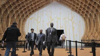 Delegationsmitglieder vor dem Konferenzzentrum in Marrakesch. Die Klimaverhandlungen kommen voran, doch gewisse Länder versuchen zu bremsen.