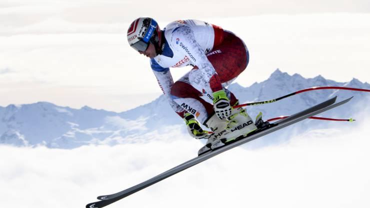 Beat Feuz bei einem Sprung auf der WM-Abfahrtspiste in St. Moritz