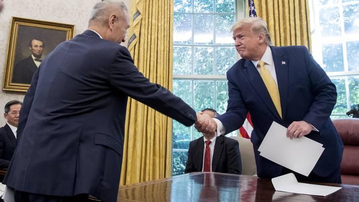 US-Präsident Donald Trump und der chinesische Vizepremier Liu He beim zweitägigen Handelstreffen im Weissen Haus in Washington.