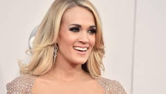 An der traditionellen Silvesterfeier am Times Square bekommen die Besucher ihre Stars nur von hinten zu sehen: Dieses Jahr entzückt unter anderem der Rücken der Country-Abräumerin Carrie Underwood (Archiv).