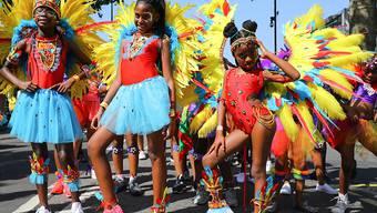 Als grosses Fest der Kulturen versteht sich der Notting Hill Carnival in London - dieses Jahr bei tropischer Hitze.