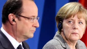 François Hollande (l.) und Angela Merkel (Archiv)