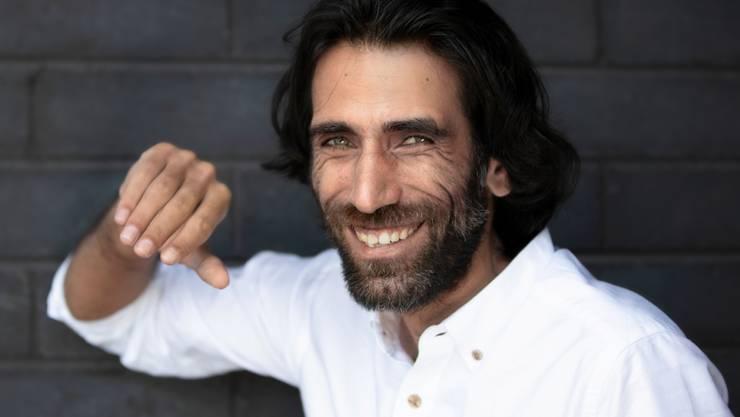 ARCHIV - Der kurdisch-iranische Journalist und Schriftsteller Behrouz Boochani. Foto: Martin Hunter/AAP/dpa