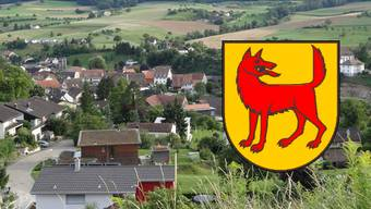 Wölflinswil mit seinem Wappen.