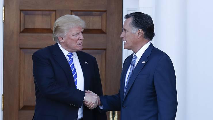 Im Wahlkampf war er der wohl schärfste parteiinterne Gegner von Donald Trump, jetzt soll er für den Spitzenposten als Aussenminister in der Trump-Administration im Rennen sein: Mitt Romney. (Archivbild vom 19. November 2016)