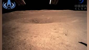 Das erste Foto von der Rückseite des Mondes und weitere Bilder der Mission im Video.