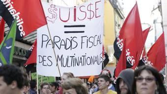 Der Rohstoff-Gipfel ist den Demonstranten ein Dorn im Auge