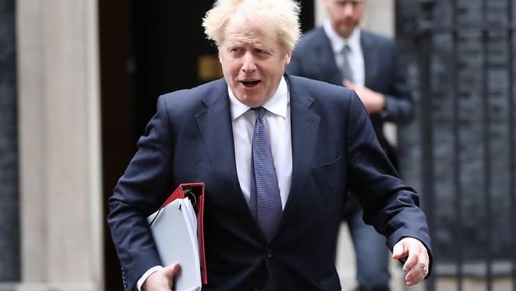 Boris Johnson, Premierminister von Großbritannien, verlässt vor einer Kabinettssitzung im Außen- und Commonwealth-Büro Downing Street 10. Foto: Jonathan Brady/PA Wire/dpa