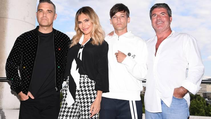 Die neue Jury der britischen Version von X Factor: Robbie Williams, Ayda Williams,  Louis Tomlinson und Simon Cowell (v. l.).