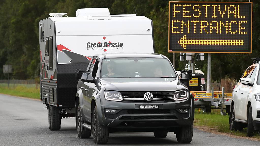 Festival goers leave the Bluesfest site after it was cancelled, Wednesday, March 31, 2021. A new locally-acquired COVID-19 case has been uncovered in northern NSW, prompting new restrictions on four councils and the cancellation of Bluesfest. (AAP Image/Jason O'Brien) NO ARCHIVING