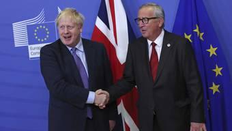 Ob Boris Johnson noch lange lacht, wird sich zeigen. Die Opposition gegen den Brexit-Deal formiert sich bereits.