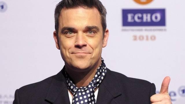 Robbie Williams zögert, wenn es um die Fortpflanzung geht (Archiv)