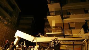 Zerstörtes Gebäude nach dem Erdbeben in L'Aquila 2009 (Archiv)